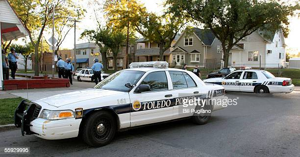 Heavy police presence surrounds a building where teenagers reportedly hang out following a minor riot October 15, 2005 in Toledo, Ohio. Approximately...