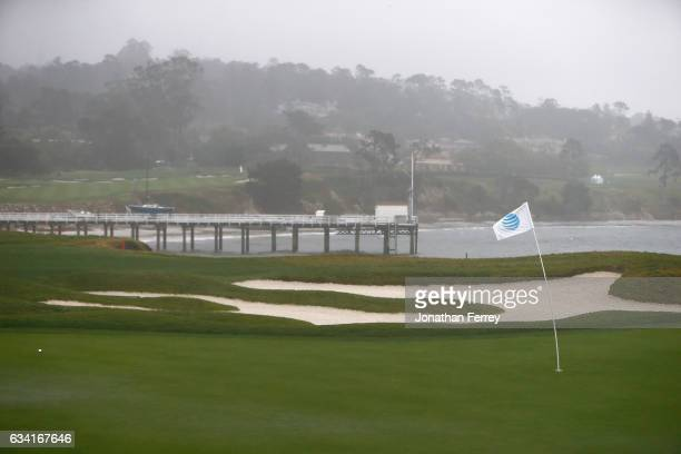Heavy rain and strong winds hammer the 17th hole allong the coast during a practie round for the ATT Pebble Beach National ProAm at Pebble Beach Golf...