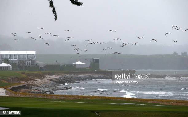 Heavy rain and strong winds hammer the 18th hole allong the coast during a practie round for the ATT Pebble Beach National ProAm at Pebble Beach Golf...