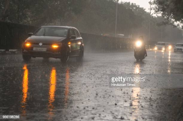 Heavy rain on May 8 2018 in Chandigarh India Dust storms rain and thunder lashed out in parts of northern India uprooting trees and blowing the roofs...