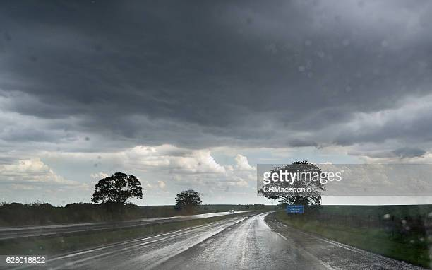 heavy rain on the highway. - crmacedonio stock photos and pictures