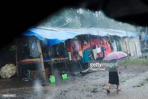 Heavy rain pours down a makeshift refugee camp in a rural area south of Laiza Fighting has resumed in June 2011 between the Burmese army and the...