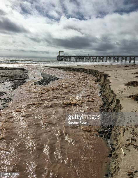 Heavy rain runoff carves through the sandy beach at Gaviota as viewed on January 8 in Gaviota State Park California Because of its close proximity to...