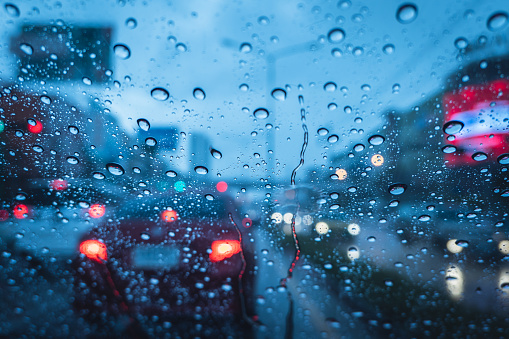 Heavy raining strom when drive at evening blue chill wet windshield 1054750504