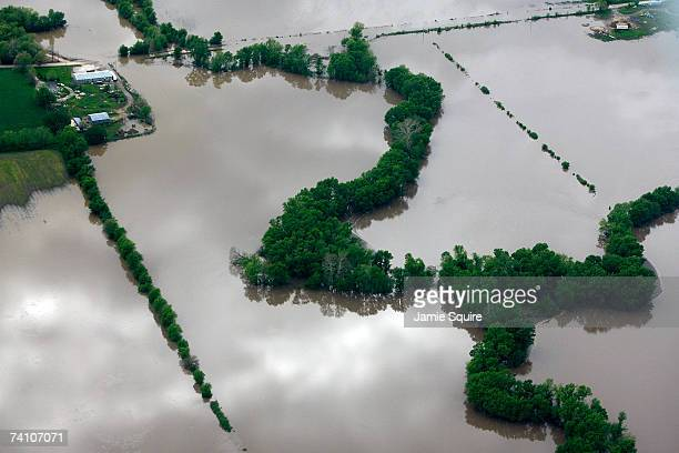 Heavy rains bring flooding from the Missouri River to a farm on May 8 2007 outside of Sibley Missouri Many towns along the Missouri River were...