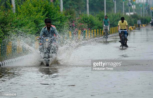 Heavy rains caused massive water logging in many sectors on June 16, 2013 in Noida, India. Rain lashed the Indian capital as the weather department...
