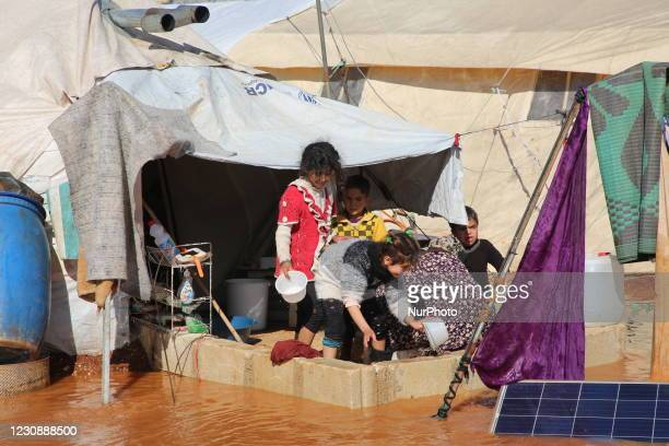 Heavy rainstorm flood syrian refugee camps In Idlib, Syria on January 31, 2021. Dozens of tents in a camp for the displaced near the town of...