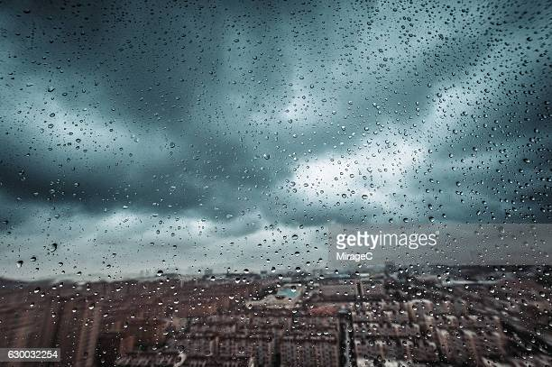 heavy rainstorm out of window - extreme weather stock pictures, royalty-free photos & images