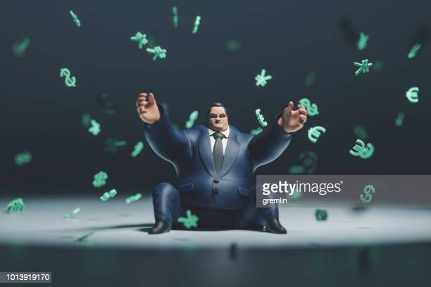 heavy rich businessman and raining currencies - multi colored suit stock photos and pictures