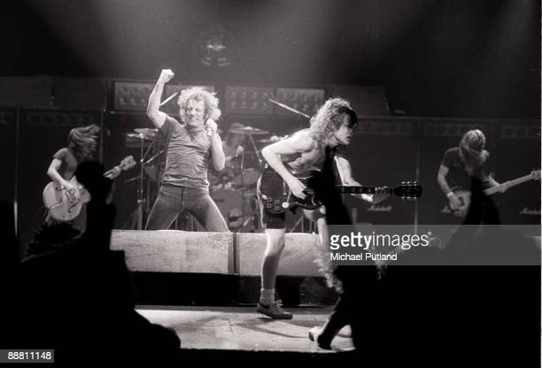 Heavy rock group AC/DC performing on tour in Europe 1980 Left to right rhythm guitarist Malcolm Young singer Brian Johnson drummer Phil Rudd...