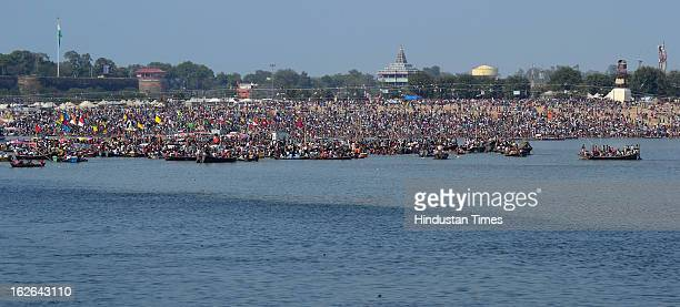 Heavy rush of devotees for taking holy dip on Maghi Purnima in Kumbh Mela area on February 25, 2013 in Allahabad, India. Around one Crore devotees...