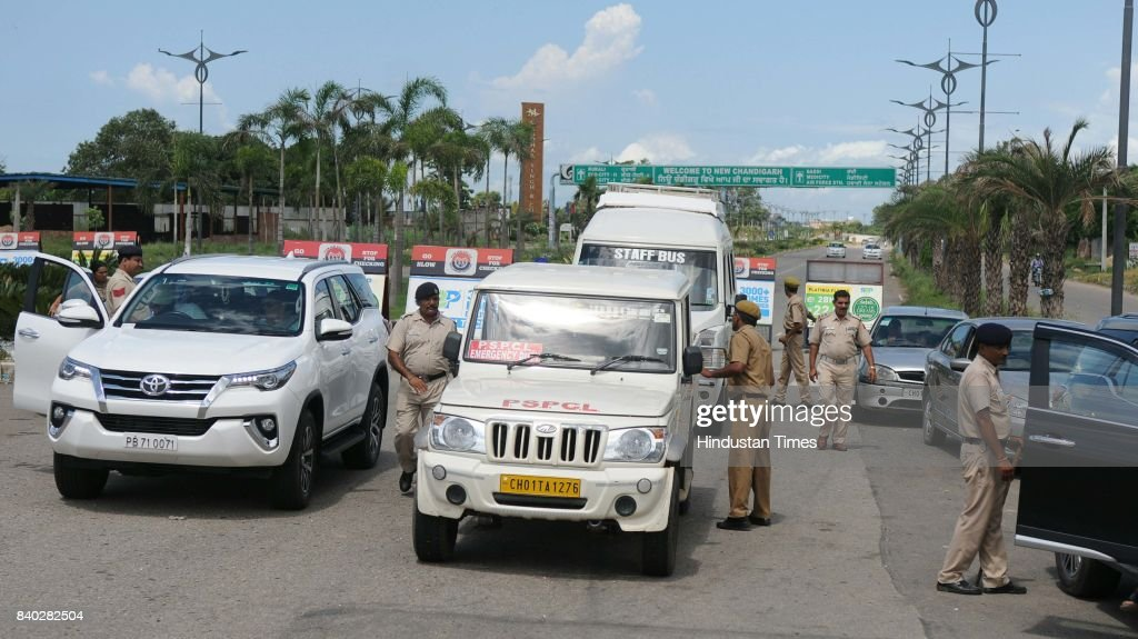 Heavy security check by Chandigarh Police near Nayagaon entry point of Chandigarh on August 28 2017 in Chandigarh India Selfstyled godman Gurmeet Ram.
