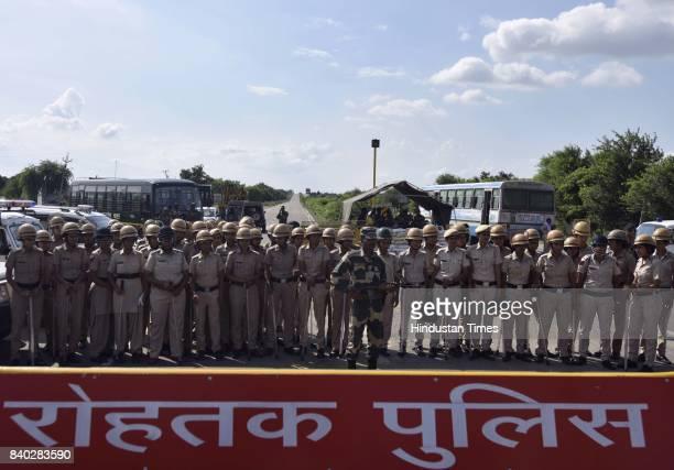 Heavy security deployed near Sunaria district jail where the sentence is to be pronounced against the Dera Sacha Sauda cult chief Gurmeet Ram Rahim...