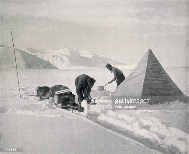 Heavy Sledging in New Snow Off Point Disappointment', December 1911, . Disappointment Camp on sea ice, Granite Harbour: an expedition member shovels...