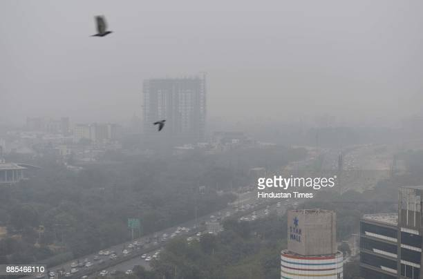 Heavy smog engulfed the city that made commuting difficult as visibility was less than 50 meters on December 4 2017 in Gurgaon India Air quality...