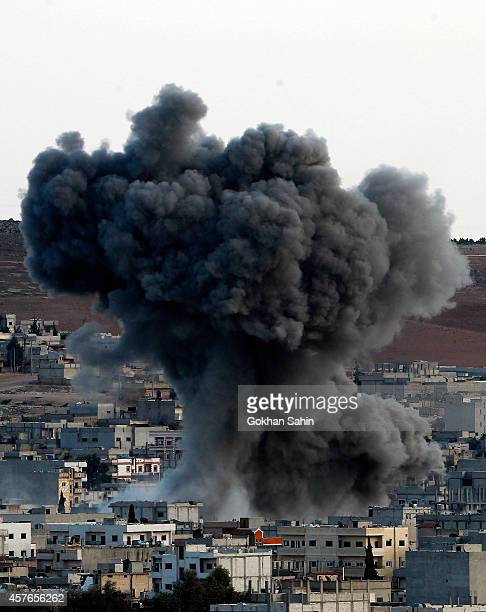 Heavy smoke and dust rise over Syrian town of Kobani after an airstrike as seen from the Mursitpinar crossing on the TurkishSyrian border in the...