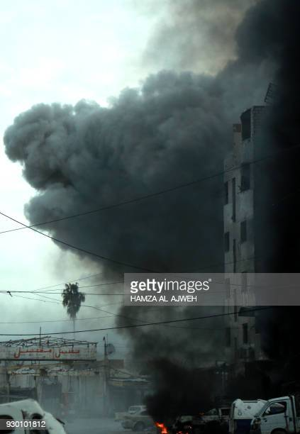 Heavy smoke billows following Syrian government bombardment in the town of Douma in the rebelheld enclave of Eastern Ghouta on the eastern outskirts...