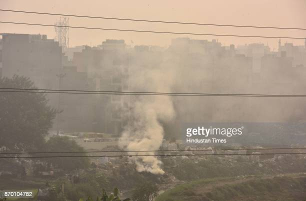 Heavy smoke due to garbage burning at Geeta Colony near Taj enclave area in East Delhi on November 4 2017 in New Delhi India Delhi's air quality...