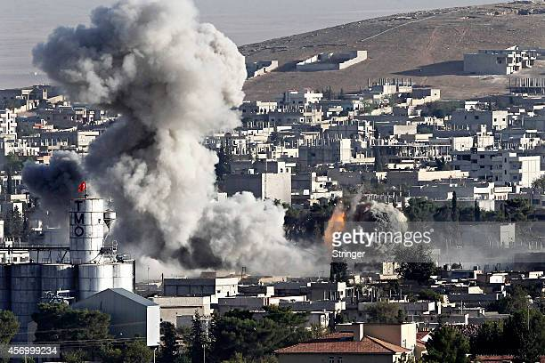 Heavy smoke from a fire caused by a strike rises in Kobani, Syria as fighting intensified between Syrian Kurds and the militants of Islamic State...