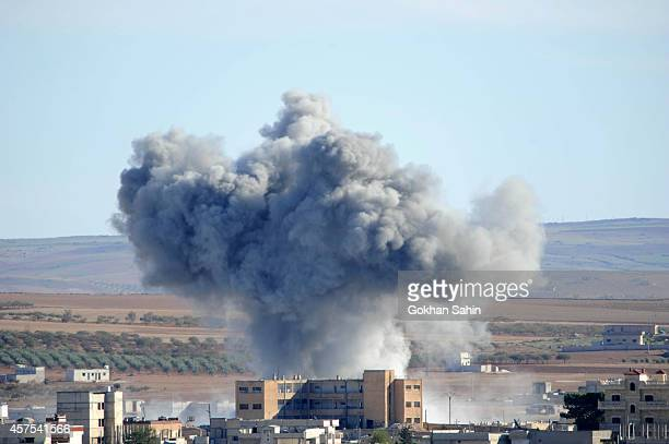 Heavy smoke from an airstrike by the U.S.-led coalition planes rises in Kobani, Syria, October 20, 2014 as seen from a hilltop on the outskirts of...