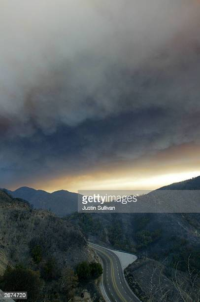 Heavy smoke from an out of control wildfire hangs over the San Bernardino valley October 28 2003 in Waterman Canyon California Wildfires continue to...