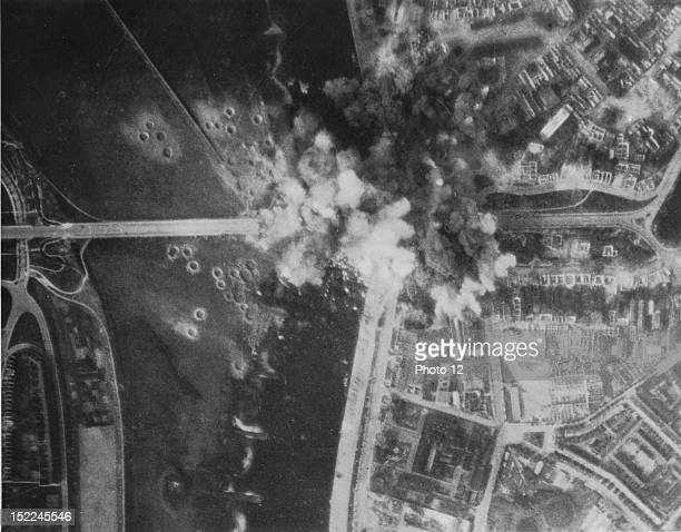 Heavy smoke from bomb bursts covers the highway bridge at Arnhem as B26 Marauders of the 9th US Air Force score direct hits