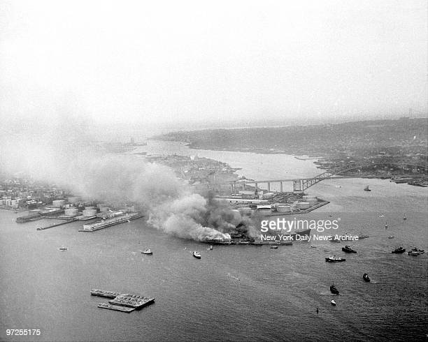 Heavy smoke pours from the British tankers Alva Cape and the American oiler Texaco Massachusetts after they collided in the Kill Van Kull channel off...