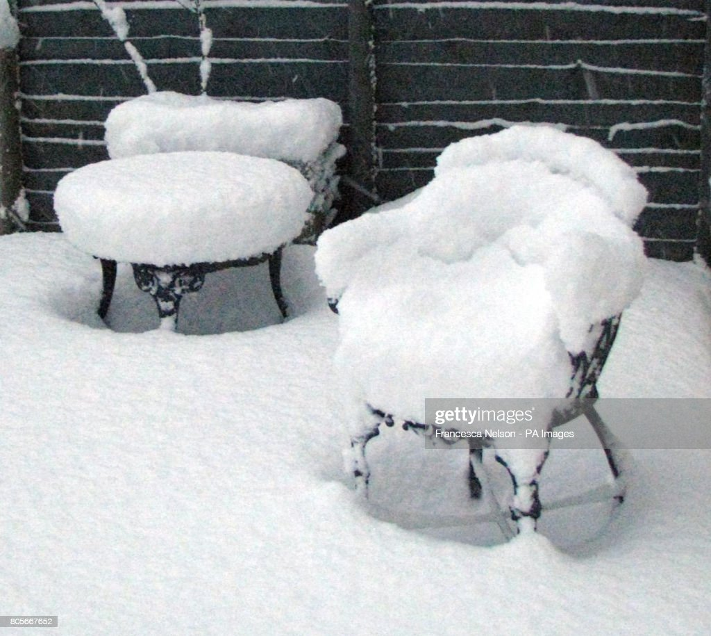 Heavy Snow Blankets Furniture In A Garden At Mardenu0027s Hill In East Sussex