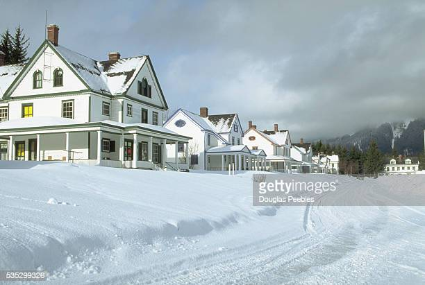 Heavy snow covers the street and front yards of houses that once served as officers' quarters at Fort William Henry Seward The fort was designated a...