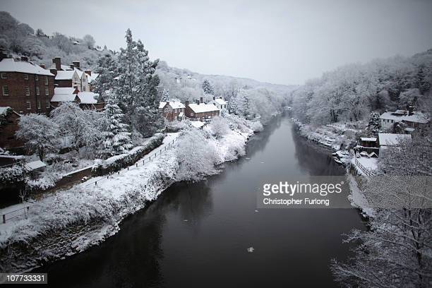 Heavy snow fall covers the Ironbridge World Heritage Site on December 22 2010 in Ironbridge United Kingdom The world's first cast iron bridge was...