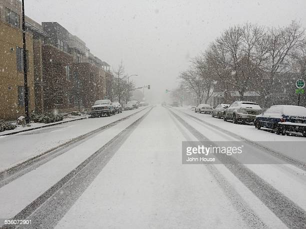 Heavy snow falling and covering the street in downtown Boulder Colorado