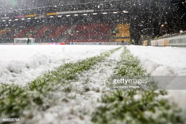 Heavy snow falling inside Go Ahead Eagles stadium forcing the cancellation of the match during the Dutch Jupiler League match between Go Ahead Eagles...