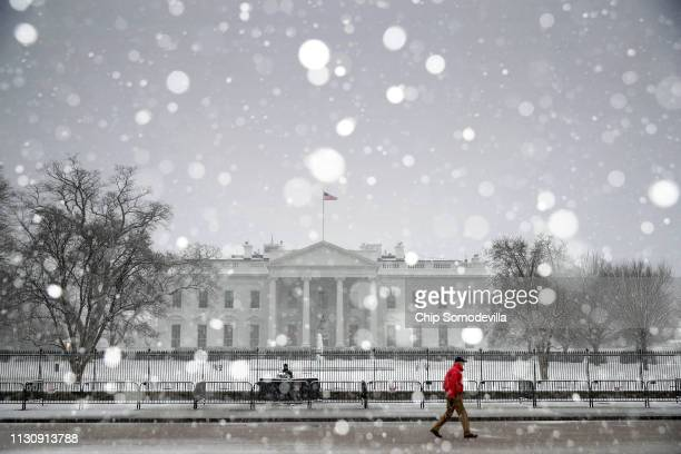 Heavy snow falls at the White House February 20 2019 in Washington DC Hazardous road conditions are likely through the morning hours as a wintery mix...