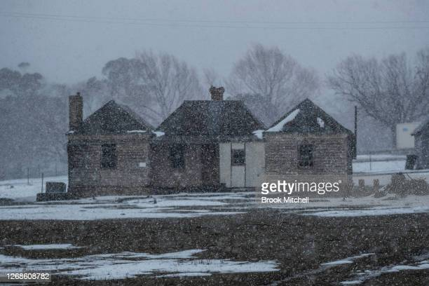 Heavy snow falls near the town of Adaminaby on August 22 2020 in Adaminaby Australia A strong weather system is currently hitting Australia's eastern...