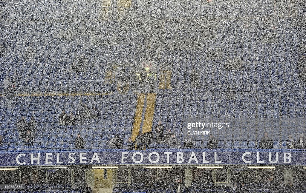 Heavy snow falls over Stamford Bridge before Chelsea's English Premier League football match against Arsenal at Stamford Bridge in London, England on January 20, 2013