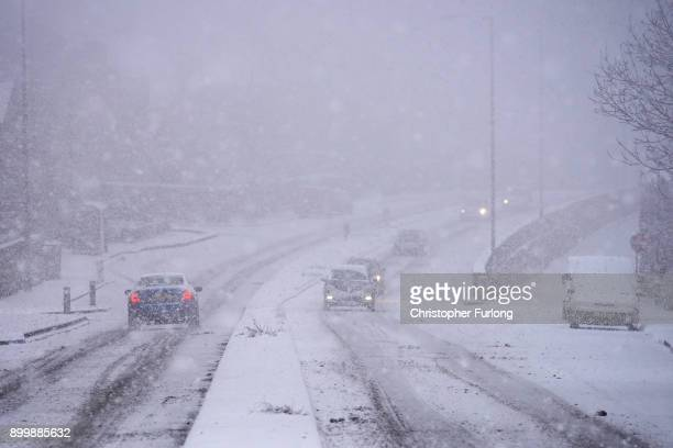 Heavy snow makes driving conditions treacherous on December 29 2017 in Huddersfield England Travellers are being warned of dangerous roads conditions...