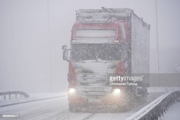 Heavy snow makes driving conditions treachorous on the M62 motorway on December 29 2017 in Huddersfield England Travellers are being warned of...