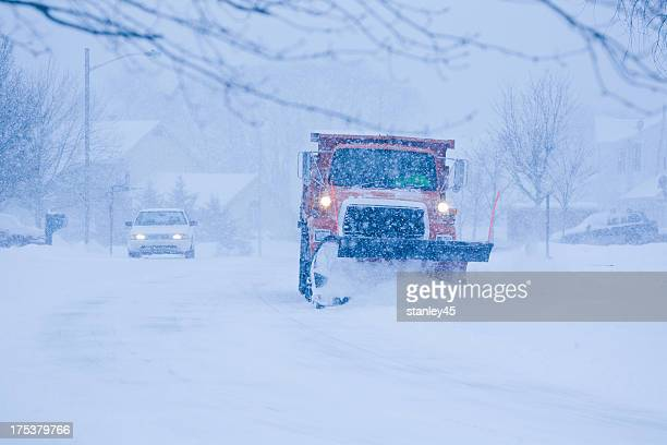 heavy snowfall and a car behind the snowplow - snowplow stock pictures, royalty-free photos & images