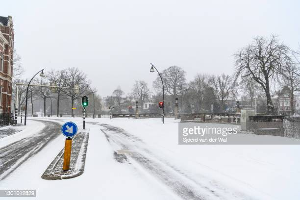 Heavy snowfall in the streets of Zwolle during a cold winter day in The Netherlands on February 7, 2021 in Zwolle, Netherlands.
