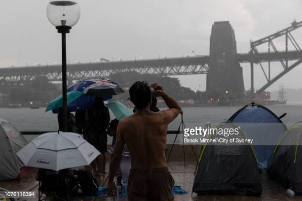 Heavy storms sweep across Sydney on New Year's Eve on Sydney Harbour on December 31 2018 in Sydney Australia
