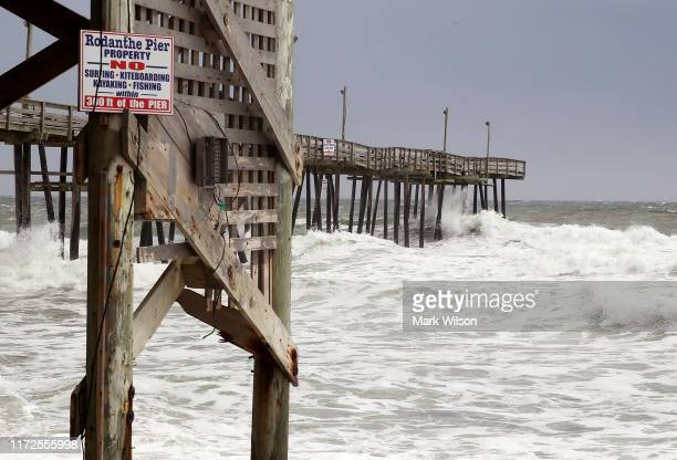 Heavy surf caused by approaching Hurricane Dorian pounds the Rodanthe Pier on September 5, 2019 in Rodanthe, North Carolina. Dorian returned to...