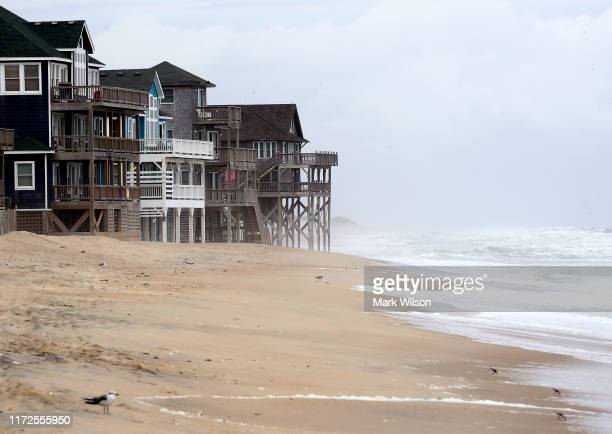 Heavy surf caused by approaching Hurricane Dorian rolls in among beach houses on September 5, 2019 in Rodanthe, North Carolina. Dorian returned to...