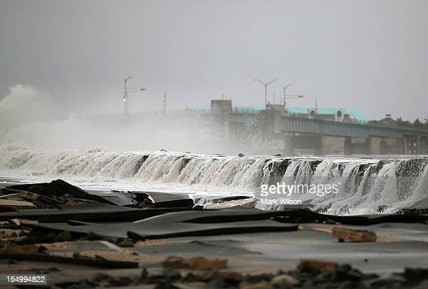 Heavy surf caused by Hurricane Sandy buckles Ocean Ave on October 30 2012 in Avalon New Jersey The storm has claimed at least 33 lives in the United...
