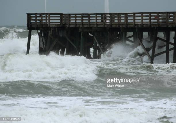 Heavy surf caused by the approach of Hurricane Dorian pounds the boardwalk September 3, 2019 in Daytona Beach, Florida. The slow-moving Dorian, which...