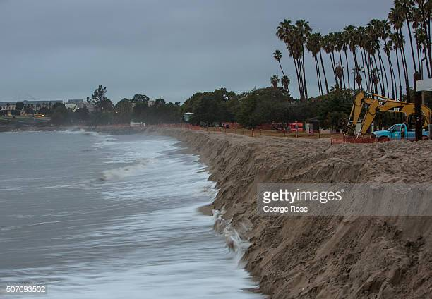 Heavy surf chews at the temporary sand berm constructed along the beach on January 20 in Goleta Beach California Because of its close proximity to...