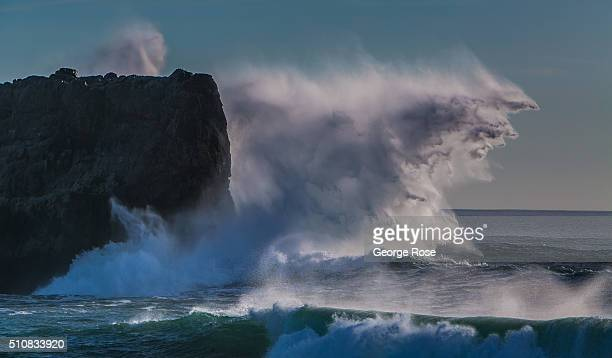 Heavy surf created by a large storm in the Gulf of Alaska sends huge waves crashing along the coastal rocks and shoreline on February 4 near the...