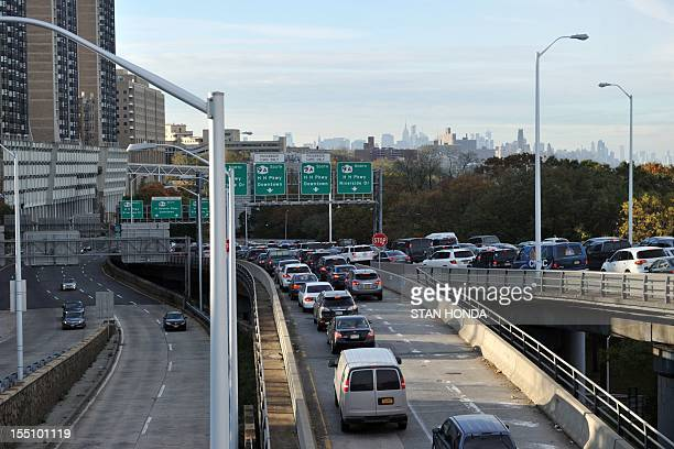 Heavy traffic exits the George Washington Bridge onto the Henry Hudson Parkway as morning commuters drive into Manhattan November 1 2012 in New York...