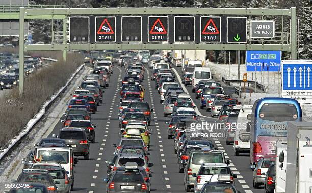 Heavy traffic fills the A8 motorway as holiday makers return home after the Christmas and New Year break near the southern German city of Holzkirchen...