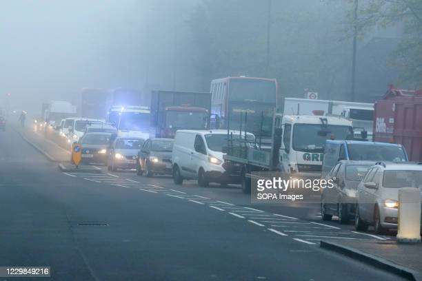 Heavy traffic in dense fog in London. Freezing cold and foggy weather is forecast across many parts of the UK.