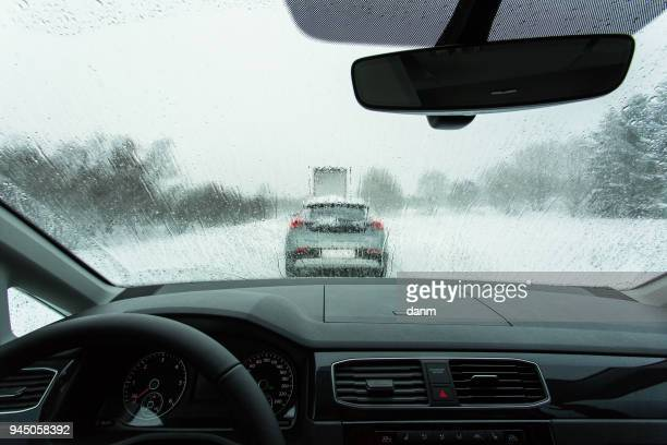 Heavy traffic in winter time, view from on board of car.